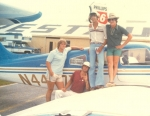 Tim Colton, pilot Dean, Shawn Wilkes, and Larry Murphy with stolen plane.  Sign in the window says 'BENNY'S OYSTER BAR